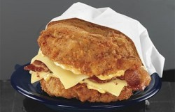 KFC Double Down, two slices of processed cheese, two slices of bacon, sandwiched between deep-fried chicken breasts