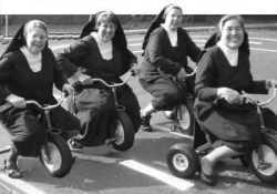 Nuns racing each other on children's bicycles