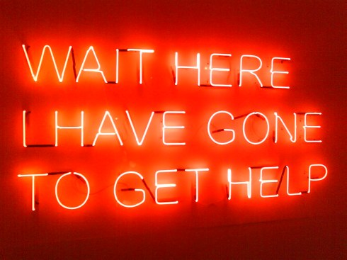 "Neon sign "" Wait here I have gone to get help"""