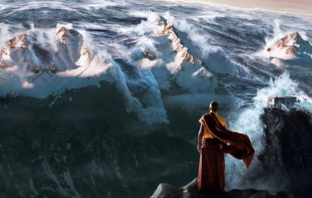 Monk watching tidal wave in 2012
