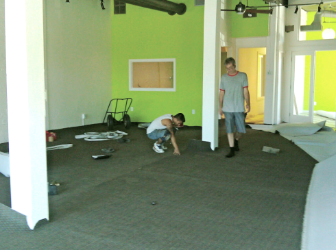 Laying down the rugs in Copeland's new office