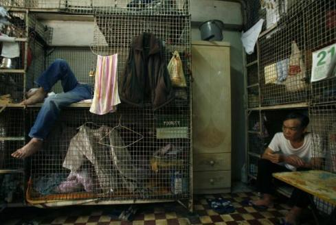 Poor living in cages on Hong Kong