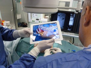 If we are both holding the iPad who's holding the scalpel?